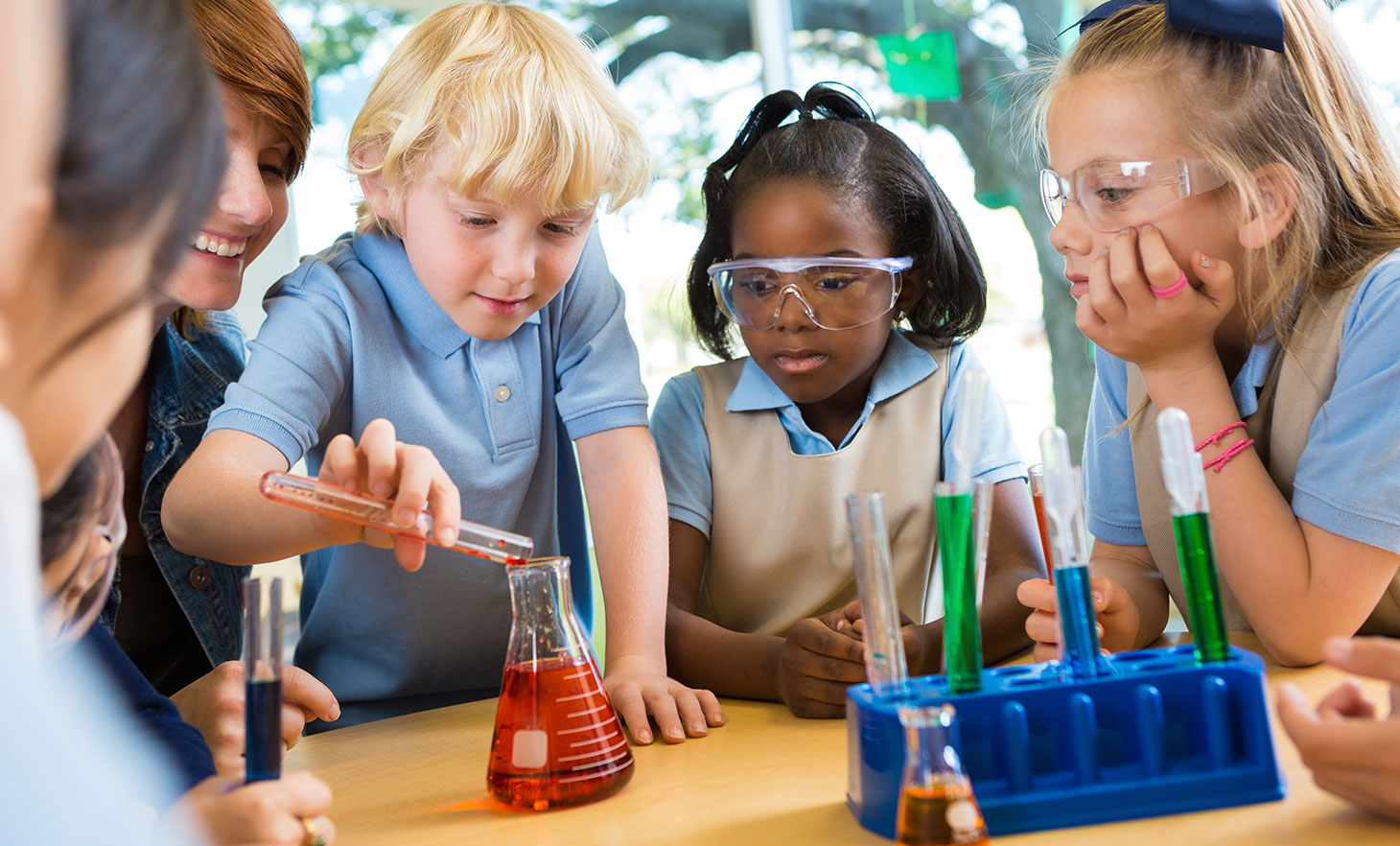 Kids using chemistry set in classroom